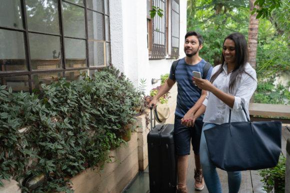 family entering rental home